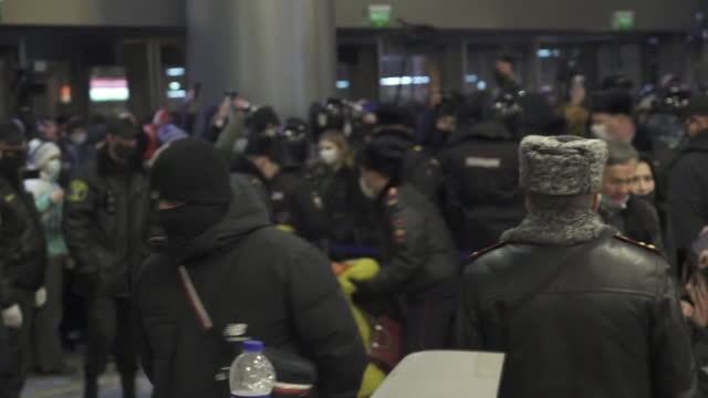 "riot police inside arrivals hall at airport, moving supporters of alexei navalny away, as he was due to arrive back in russia at that airport before... - ""bbc news"" stock videos & royalty-free footage"