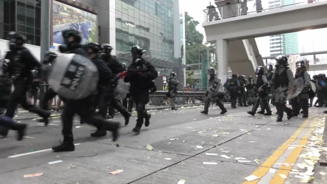 riot police is seen during a protest of pro-democracy supporters in the streets of hong kong on october 1 as the city observes the national day... - communist flag stock videos & royalty-free footage