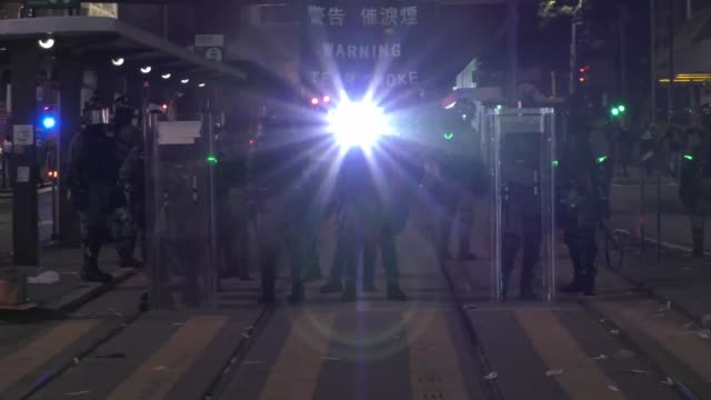 stockvideo's en b-roll-footage met riot police is seen during a protest of prodemocracy supporters in the streets of hong kong on october 1 as the city observes the national day... - bod