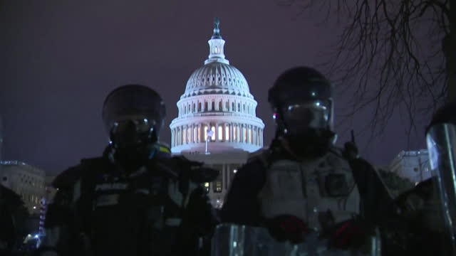 riot police keep guard outside the capitol building after the building was stormed by rioters who were supporters of president donald trump angry... - congress stock videos & royalty-free footage