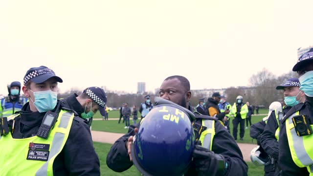 "riot police officer removes their helmet on march 20, 2021 in london, england. ""world wide rally for freedom"" protests, with apparent links to the... - helmet stock videos & royalty-free footage"