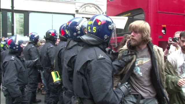 riot police on tuesday forced their way into a building in central london occupied by anti capitalists and clashed with protesters demonstrating in... - g8 summit stock videos & royalty-free footage
