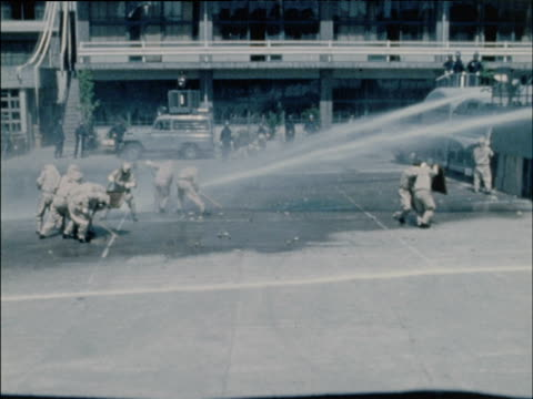 Riot police practice using water cannons in drill Tokyo 1968