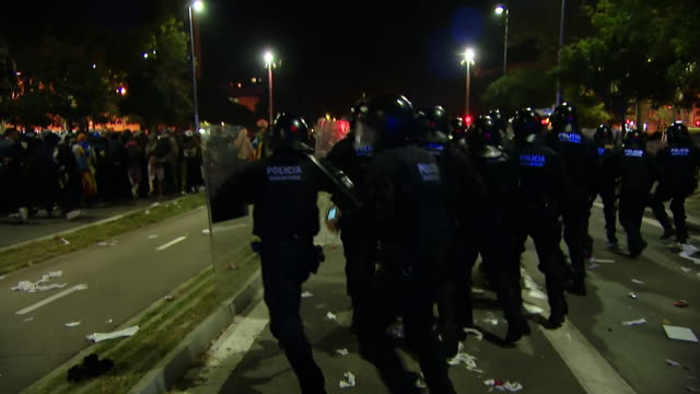 riot police push back protesters in barcelona who are protesting over the imprisonment of catalan proindependence leaders for sedition during the... - prison riot stock videos & royalty-free footage