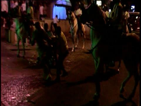 riot police restrain football fan on ground during violent disturbances at european championship finals albufeira 16 jun 04 - trattenere video stock e b–roll