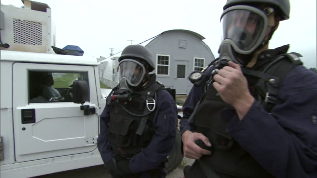 riot police stand on a street in complete gear. - weapon stock videos & royalty-free footage