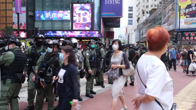 riot police standby during a china's national day in hong kong on october 1 which commemorates the 71st anniversary of the establishment of the... - law stock videos & royalty-free footage