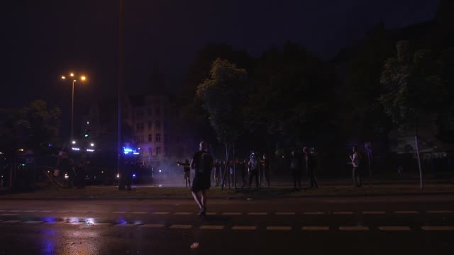 riot police use a water cannon against anti-fascist and anti-capitalist black bloc g20 protesters build a burning roadblock in the altona nord... - water cannon stock videos & royalty-free footage