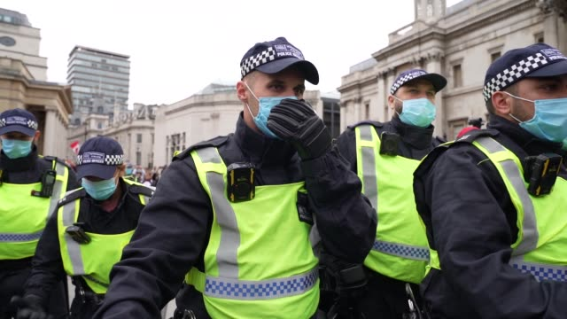 """riot police walk trough protesters as protesters clash with police officers during a """"we do not consent"""" anti-lockdown rally at trafalgar square on... - agricultural equipment stock videos & royalty-free footage"""