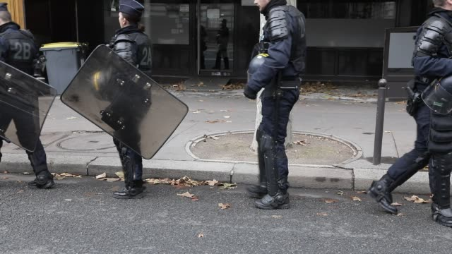 vidéos et rushes de riot police walking during a demonstration against unemployment and precariousness at the call of several unions including the cgt in paris on... - isore vincent