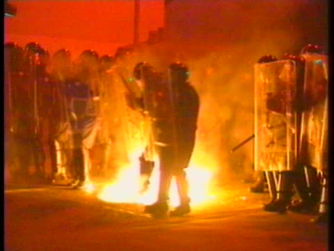 rioters hurl a molotov cocktail at security forces during theêdrumcreeêconflict inêportadown, northern ireland. - (war or terrorism or election or government or illness or news event or speech or politics or politician or conflict or military or extreme weather or business or economy) and not usa stock videos & royalty-free footage