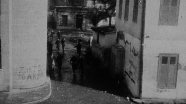 vídeos de stock, filmes e b-roll de 1973 montage rioters rampaging in the streets, police forces combating them / united kingdom - 1973