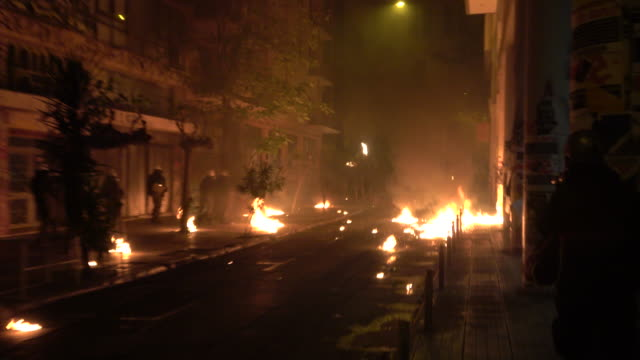 rioters throw stones and molotov cocktails at riot police near the polytechnic school in athens on november 17 2018 //// the 45th polytechnic... - confrontation stock videos & royalty-free footage