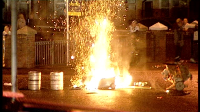 vídeos de stock e filmes b-roll de rioting in belfast following orange order parades more of youths throwing petrol bombs and missiles at riot police and armoured police vehicles/... - belfast