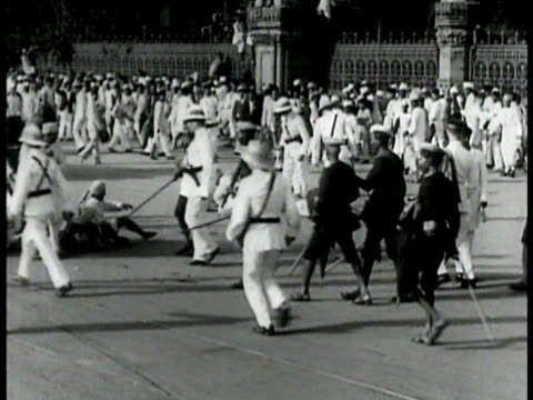 Rioting on streets Indian police crowds VS Police chasing down rioters fighting them w/ sticks whips