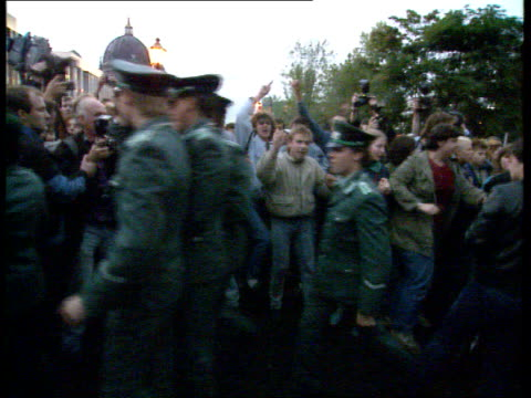 Riots as Gorbachev leaves EAST GERMANY East Berlin EXT / DUSK Mass demonstrators chanting Demonstrators towards chanting *** BEWARE Mikhail Gorbachev...