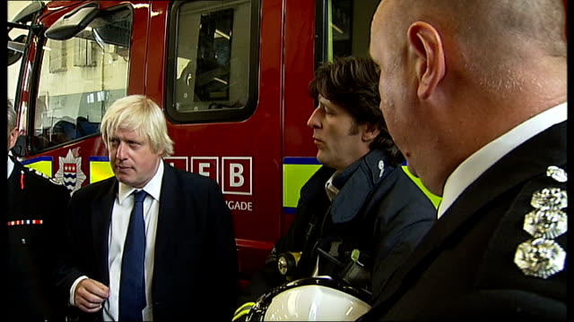 Riots Boris Johnson visits fire station in Stoke Newington Johnson chatting to firefighters SOT / Johnson being given cup of tea / Johnson chatting...