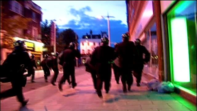 boris johnson visits peckham lib riot police in peckham high street during rioting fireworks going off in high street during rioting - peckham stock videos and b-roll footage