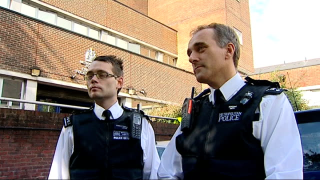 croydon revisited; day residents along pas police line sergeant rob smith interview sot young black man turning to show reporter hood on jacket man... - sergeant stock videos & royalty-free footage