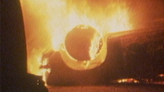 government report says shooting rioters could be justified april 1981 brixton night line of riot police with shields raised in street pan to... - ブリックストン点の映像素材/bロール