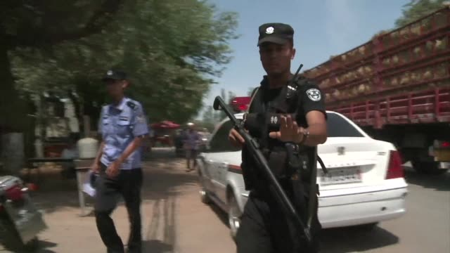 riots in chinas ethnically divided xinjiang region have left at least 27 people dead according to state media which says policemen opened fire on... - xinjiang province stock videos & royalty-free footage