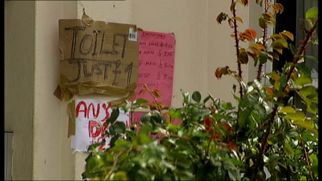 notting hill carnival to go ahead as scheduled t30081005 woman wearing elaborate carnival costume handmade sign saying 'toilet just one pound'... - intricacy stock videos & royalty-free footage