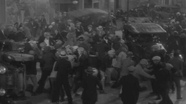 ws riots on streets / - mob stock-videos und b-roll-filmmaterial