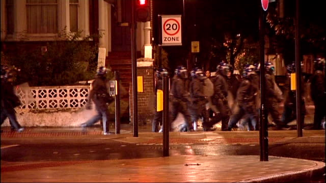 police hit back at politicians after criticism of tactics used to combat unrest t08081122 london brixton line of riot police along street riot police... - police line up stock videos and b-roll footage