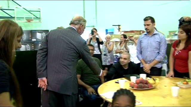 vídeos de stock e filmes b-roll de prince charles visits areas hit by violence; london: tottenham: int prince charles meeting people whose homes were destroyed in the tottenham riots... - croydon inglaterra