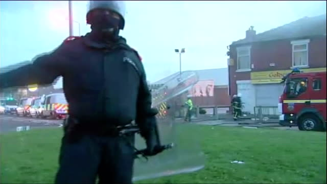 salford general views: day and night; police vehicles and fire engine with flashing lights as other traffic drives past / smoke rising from row of... - salford quays stock videos & royalty-free footage