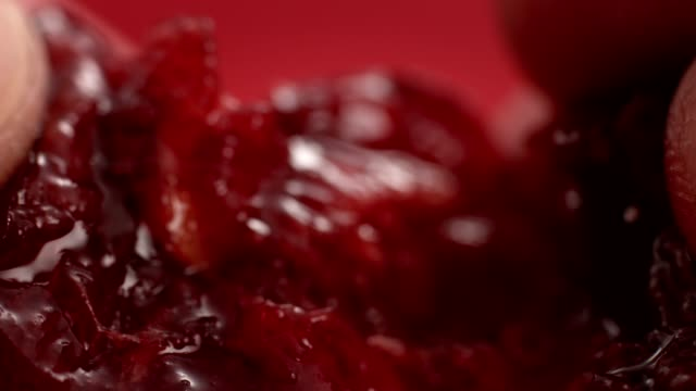 Ripe, juicy cherry split in half. Extreme close up
