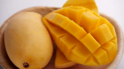 Ripe Slide of mangoes. Organic summer tropical fruit, Ripe Sliced Mango Squared rotation in 4k slow motion