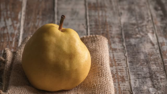 ripe yellow asian pear on rustic wooden table - pear stock videos & royalty-free footage