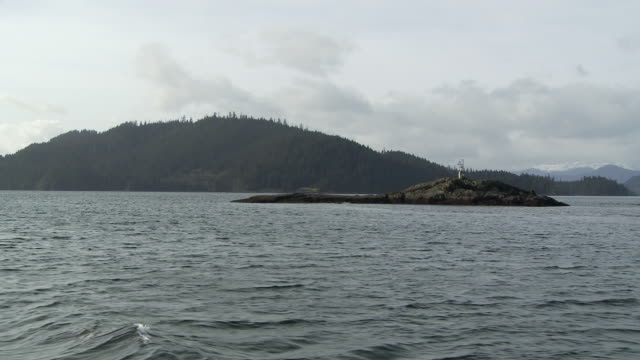 ws pov rippled water and island / sandspit, british columbia, canada - island stock videos & royalty-free footage