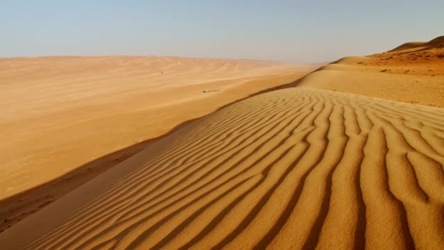 ds ripples on sand dunes in the desert in oman - sand dune stock videos and b-roll footage