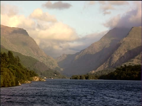 rippling lake surrounded by mountains of snowdonia national park - snowdonia stock videos & royalty-free footage