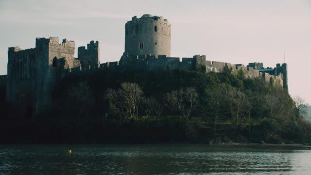 stockvideo's en b-roll-footage met tu rippling moat surrounding pembroke castle / pembroke, wales, united kingdom - pembroke
