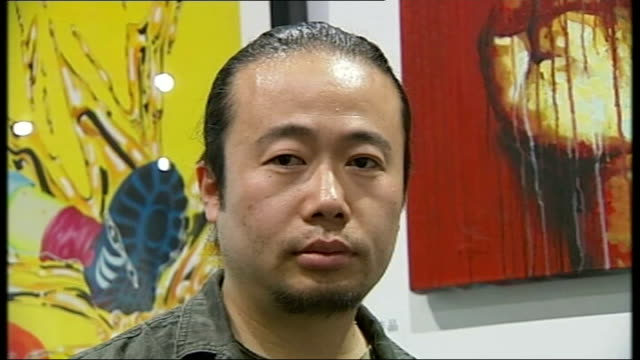 rise in auction prices of chinese contemporary art sheng qi standing in front of wall of paintings sheng qi interview sot close up painting of hand... - finger painting stock videos and b-roll footage