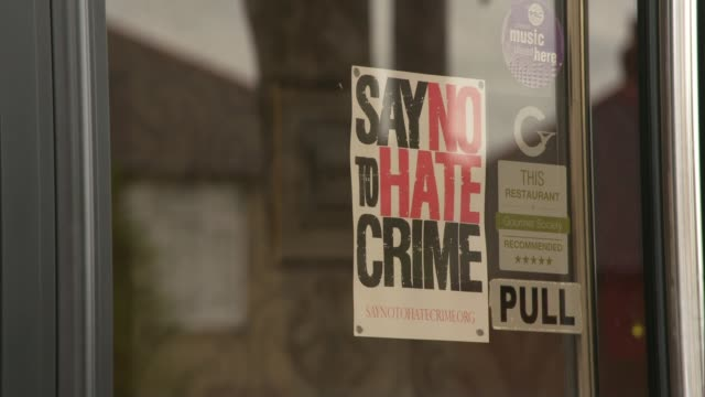 "rise in hate crime since eu referendum; ext sign over the bindi indian restaurant poster in window ""say no to hate crime"" int shafiqul islam... - brexit stock videos & royalty-free footage"