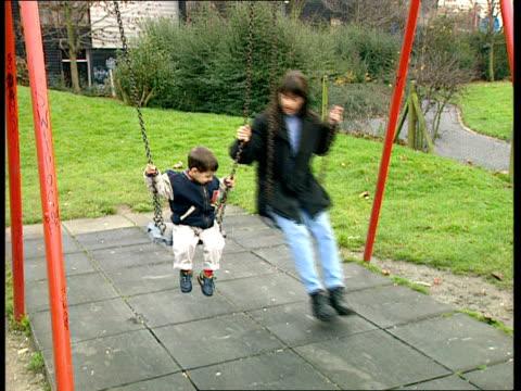 rise in teenage pregnancies; nat: sue saville england: north london: camden: ext maya elmelem on swings with son jake in playground maya elmelem... - imagination stock videos & royalty-free footage