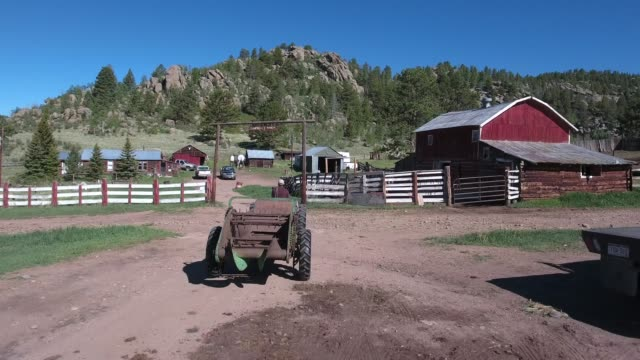 rise over tractor reveal house and barns .mov - ranch stock videos & royalty-free footage