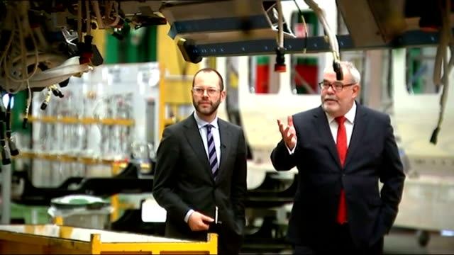 GDP rises by 07 per cent in 2014 third quarter Bombardier Transportation Various of workers on Bombardier factory assembling train carriages...