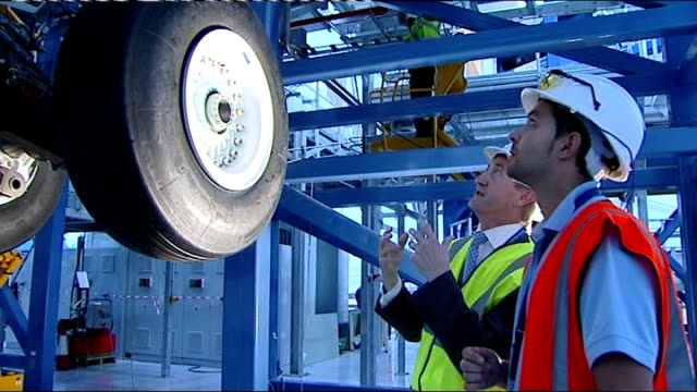 vídeos de stock, filmes e b-roll de airbus factory int shots of worker checking plane wheels in factory neil scott and another looking at wheels neil scott interview sot if they keep... - produto interno bruto