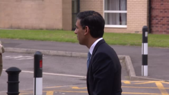 rishi sunak and ben wallace visit catterick garrison; england: north yorkshire: catterick: ext rishi sunak mp arriving and chatting with ben wallace... - ben wallace stock videos & royalty-free footage