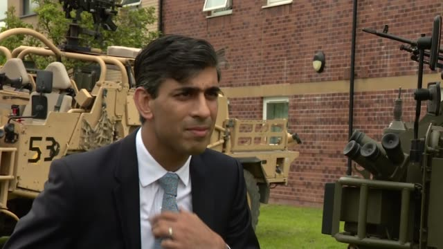 rishi sunak and ben wallace visit catterick garrison; england: north yorkshire: catterick: ext rishi sunak mp interview sot - ben wallace stock videos & royalty-free footage