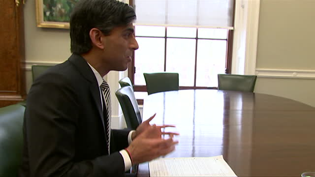 rishi sunak, chancellor of the exchequer, on zoom call with young workers, holds up budget document, ahead of 2021 budget, which pledges to support... - holding stock videos & royalty-free footage