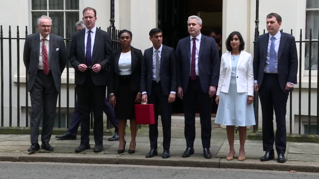 rishi sunak chancellor of the exchequer poses outside number 11 downing street with his treasury team on budget day - place of work stock videos & royalty-free footage