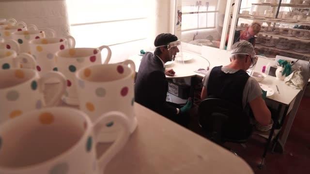 staffordshire stokeontrent emma bridgewater factory int rishi sunak mp printing stars on 'plan for jobs' plate / mugs / sunak holding up plate /... - mug stock videos & royalty-free footage