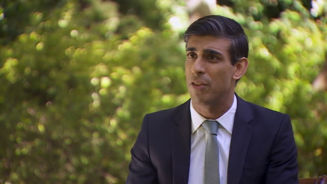 rishi sunak saying the government will ask businesses to contribute to its furloughing scheme once the country enters into the coronavirus recovery... - sharing stock videos & royalty-free footage
