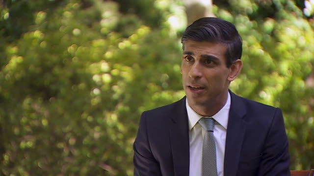 rishi sunak saying the government will extend the coronavirus furloughing scheme for another four months - stretching stock videos & royalty-free footage